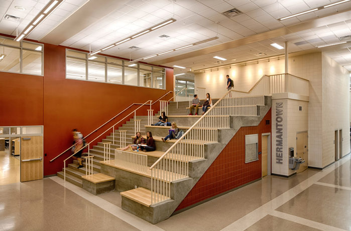 students studying on large staircase